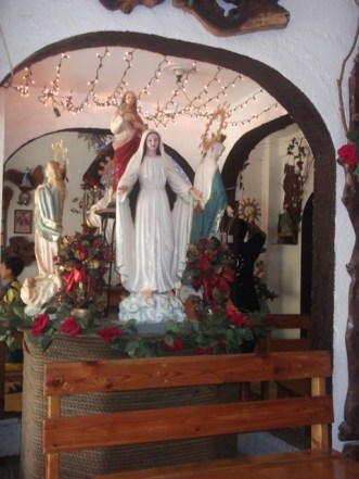 Inside the chapel's main place. The healing and praying area. A lot of Mama Mary and other Saint's images are in this room.