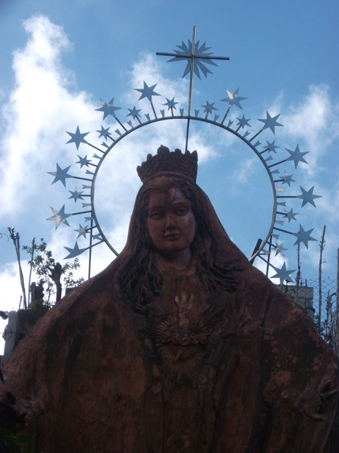 This huge Mama Mary image greets the people and catches attention who ever is the passer by.
