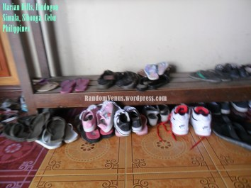 The shoes and slippers of the visitors.