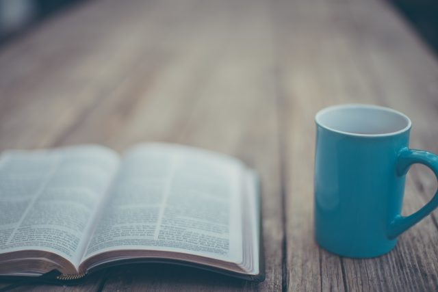 Bible and a blue cup - the Lord