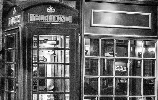 Noisy Telephone Booth at Night
