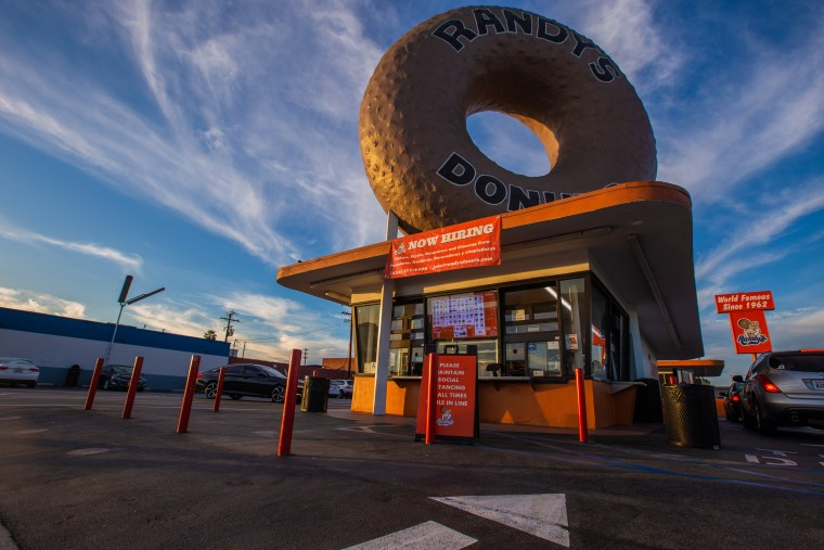 Exterior of Randy's Donuts Inglewood location with giant rooftop donut and drivethru