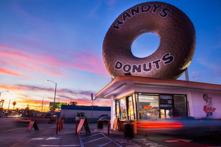 Exterior of Randy's Donuts Inglewood location with giant rooftop donut