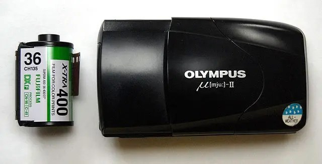 The Olympus Mju II is only slightly taller than a 35mm film cartridge.