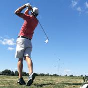 TJ swinging a golf club, rangefinder guy