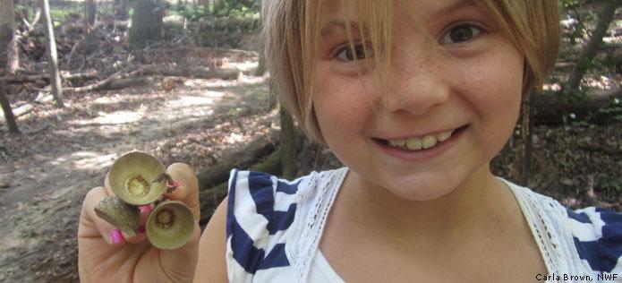 Girl showing acorn