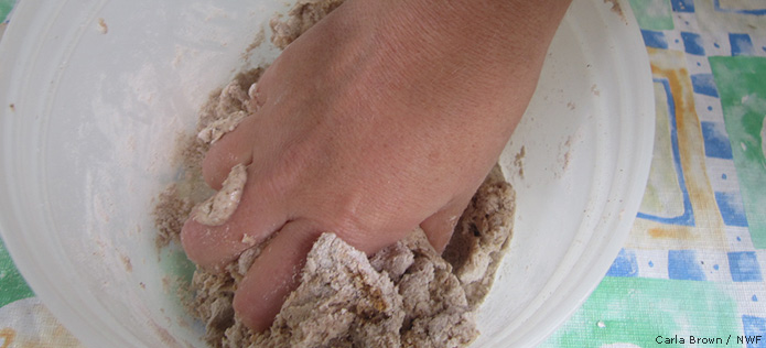 Mixing sawdust and play dough