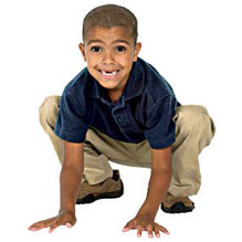 Boy crouchiung like frog