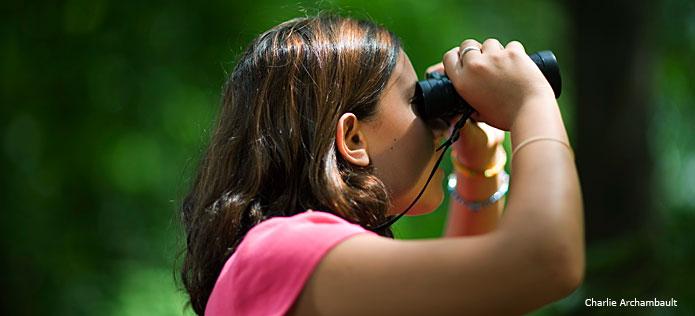 Girl using binoculaurs
