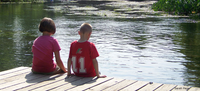 Children sitting on dock