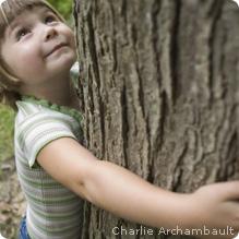 girl hugs big tree