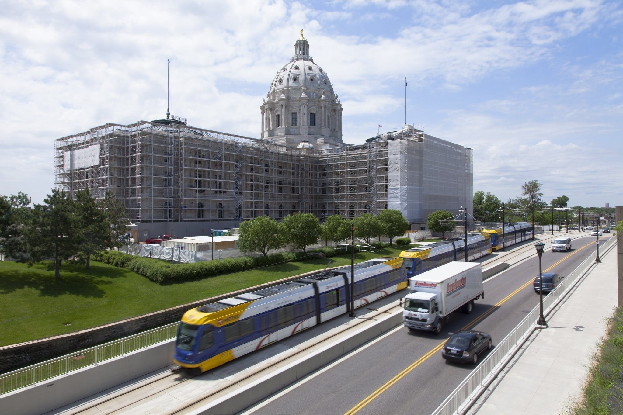 Minnesota State Capital behind street with rail transit