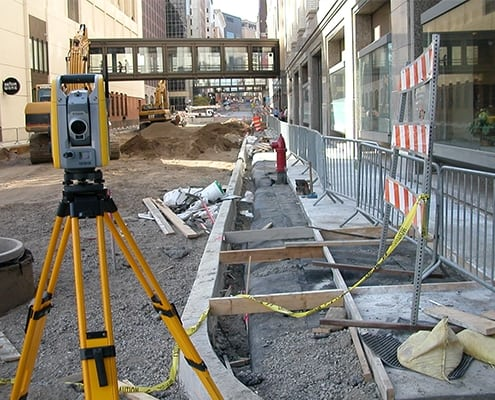 survey equipment on roadway under construction