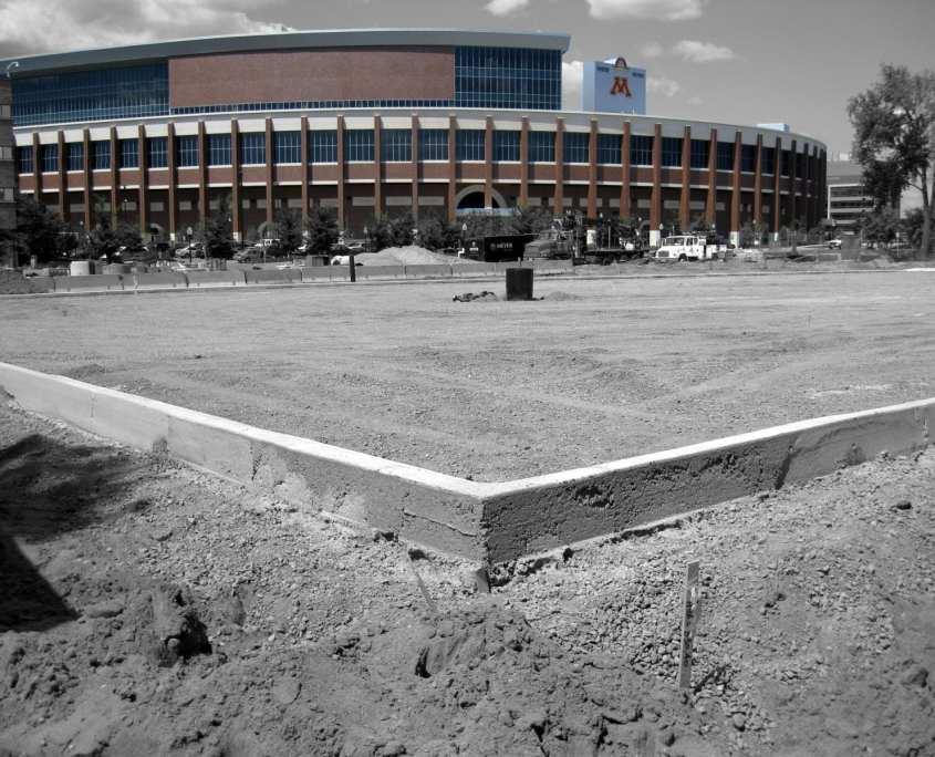University of Minnesota with dirt parking lot