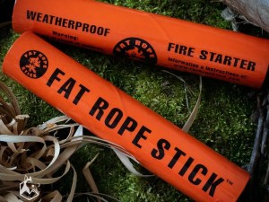Fat Rope Stick fire tinder packaging sitting on mossy rock