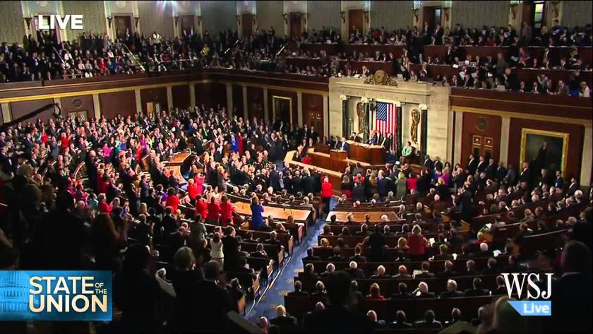 Republicans sit while Democrats Applaud the President