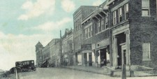 An undated photo shows the building, fourth from right, in the early 1900s. The buildings to the right no longer stand.