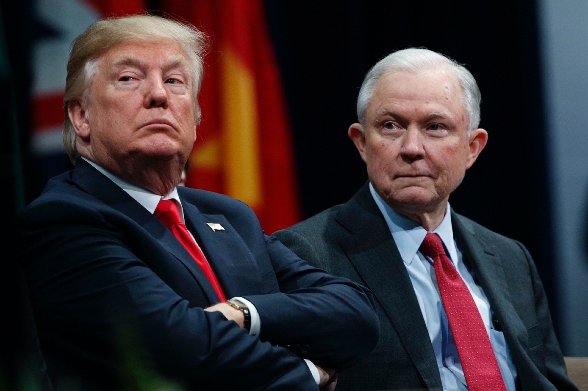 President Donald Trump sits with Attorney General Jeff Sessions during the FBI National Academy graduation ceremony in Quantico, Va. Dec. 15, 2017 (AP Photo/Evan Vucci, File)