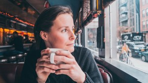 Woman drinking coffee in diner