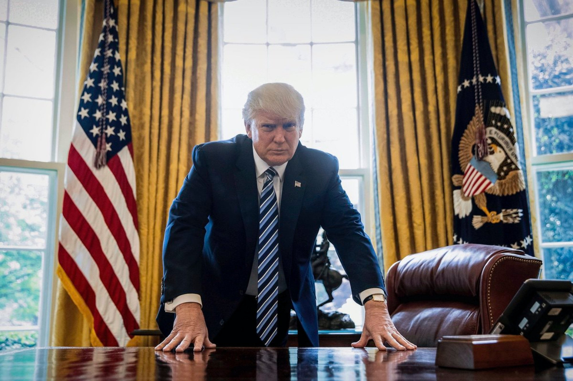President Donald Trump poses for a portrait in the Oval Office in Washington after an interview with The Associated Press. April 21, 2017 (AP Photo/Andrew Harnik)