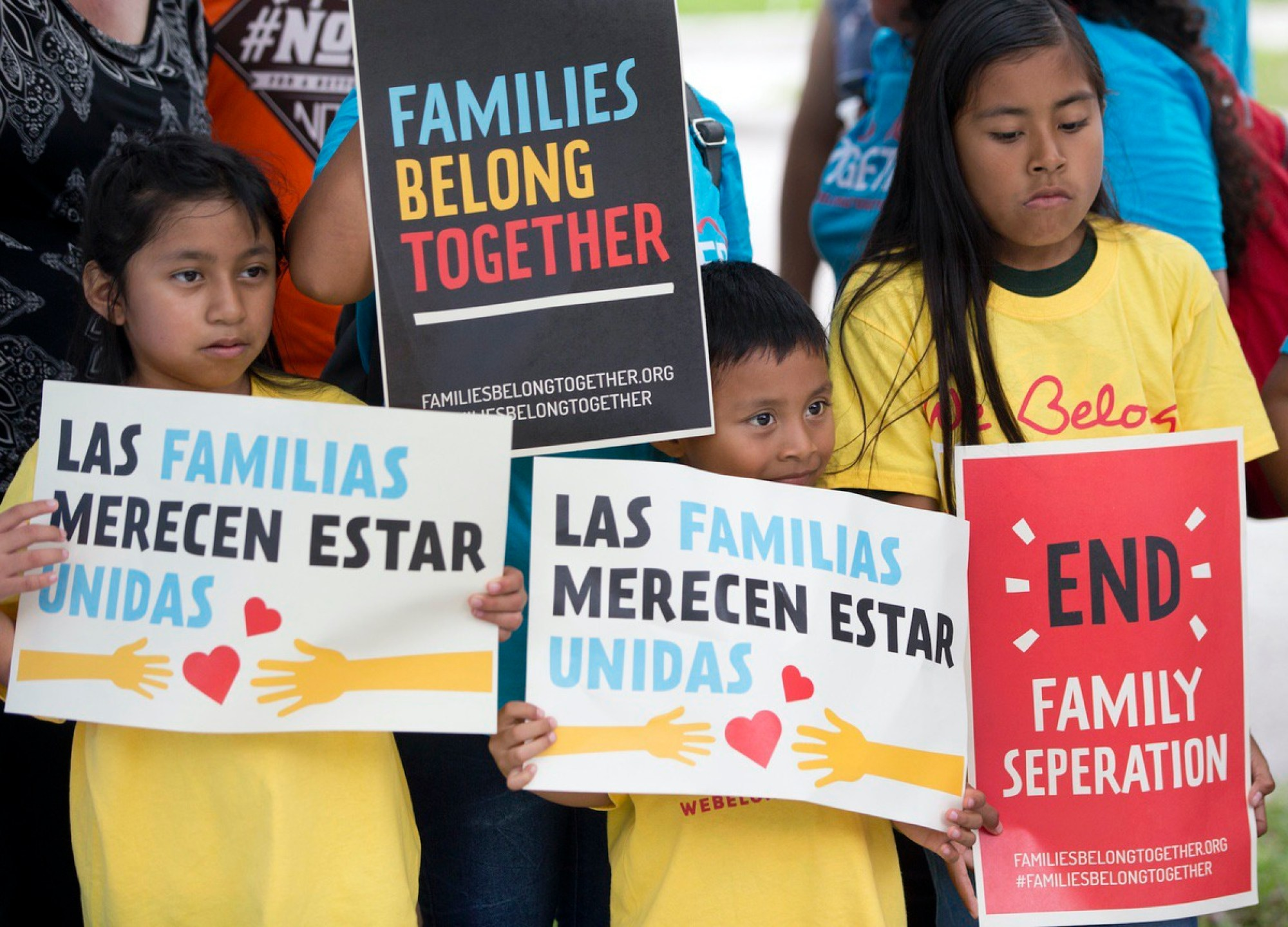 A group of children hold up signs during a demonstration in front of the Immigration and Customs Enforcement (ICE) offices, Friday, June 1, 2018, in Miramar, Fla. (AP Photo/Wilfredo Lee)