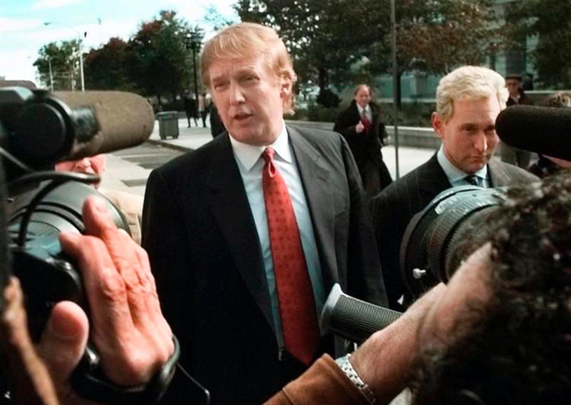 Donald Trump, left, is seen outside the Federal Courthouse in Newark, N.J., with Roger Stone, the director of Trump's presidential exploratory committee Monday, Oct. 25, 1999, for the swearing-in of Trump's sister as a federal appeals court judge. (AP Photo/Daniel Hulshizer)