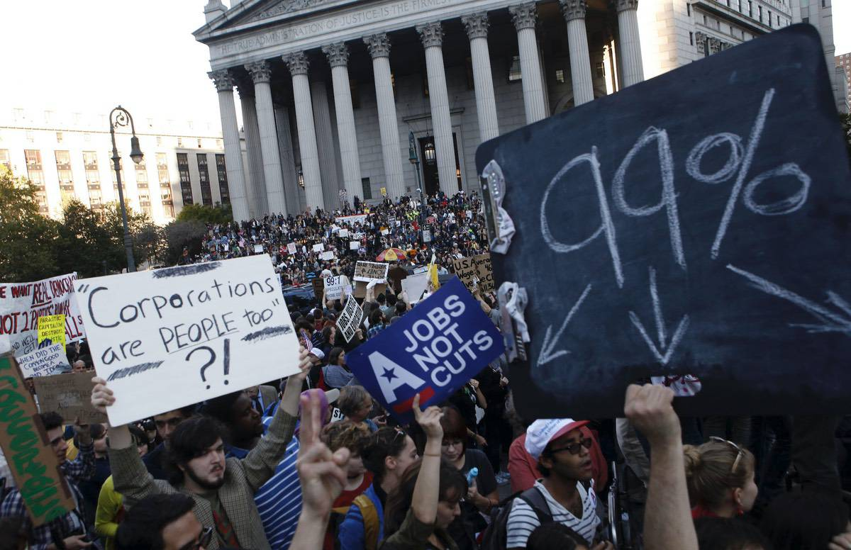 Occupy Wall Street protesters join a labor union rally in Foley Square before marching on Zuccotti Park in New York's Financial District. Wednesday, Oct. 5, 2011, file photo, (AP Photo/Jason DeCrow, File)
