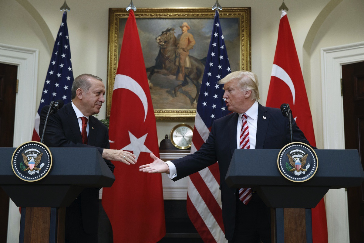 President Donald Trump with Turkish President Recep Tayyip Erdogan in the Roosevelt Room of the White House, Tuesday, May 16, 2017, in Washington. (AP Photo/Evan Vucci)