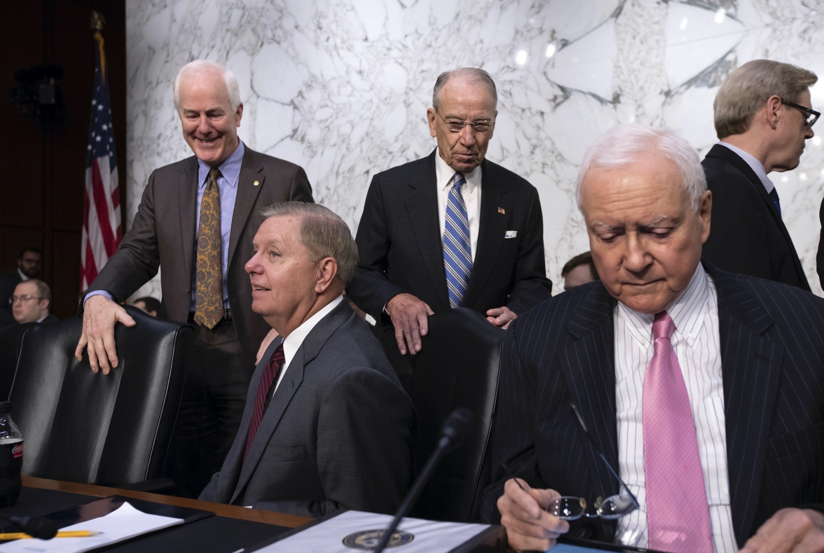 Republican members of the Senate Judiciary Committee, from left, Sen. John Cornyn, R-Texas, Sen. Lindsey Graham, R-S.C., Chairman Chuck Grassley, R-Iowa, and Sen. Orrin Hatch, R-Utah, arrive for the second day of the confirmation hearing for Supreme Court nominee Brett Kavanaugh, on Capitol Hill in Washington, Wednesday, Sept. 5, 2018. (AP Photo/J. Scott Applewhite)