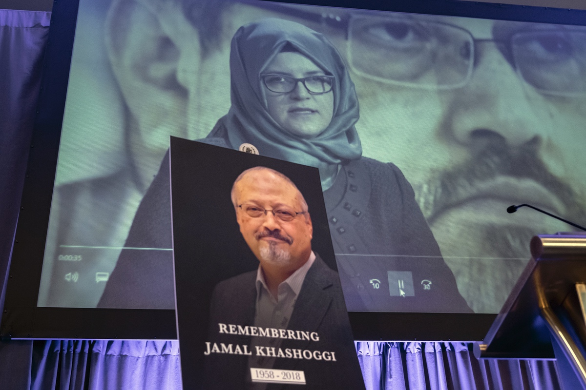 A video image of Hatice Cengiz, fiancee of slain Saudi journalist Jamal Khashoggi, is played during an event to remember Khashoggi, a columnist for The Washington Post who was killed inside the Saudi Consulate in Istanbul on Oct. 2, in Washington, Friday, Nov. 2, 2018. (AP Photo/J. Scott Applewhite)