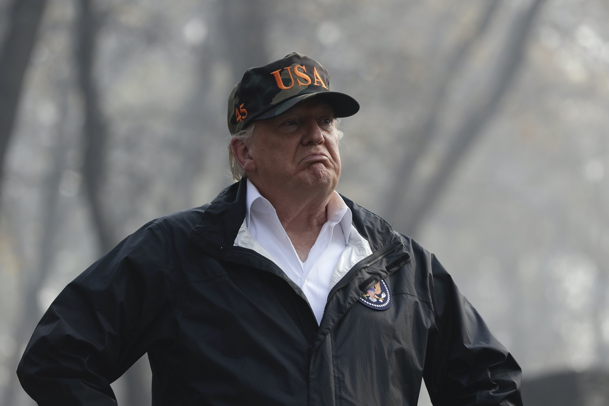 President Donald Trump visits a neighborhood impacted by the wildfires, Saturday, Nov. 17, 2018, in Paradise, Calif. (AP Photo/Evan Vucci)