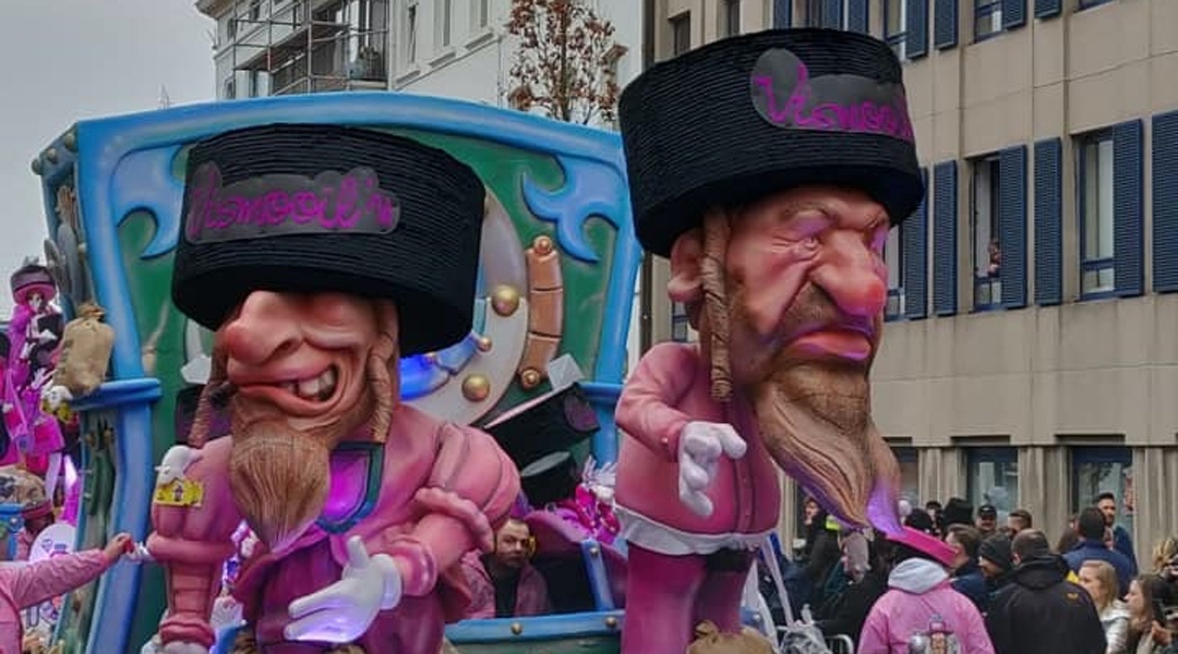A parade float at the Aalst Carnaval in Belgium features anti-Semitic caricatures of Orthodox Jews atop money bags, March 3, 2019. (Photograph from FJO)