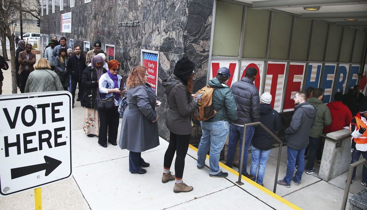 People line up to vote on the last day of early voting at the Minneapolis Early Vote Center Monday, Nov. 5, 2018, in Minneapolis. (AP Photo/Jim Mone)