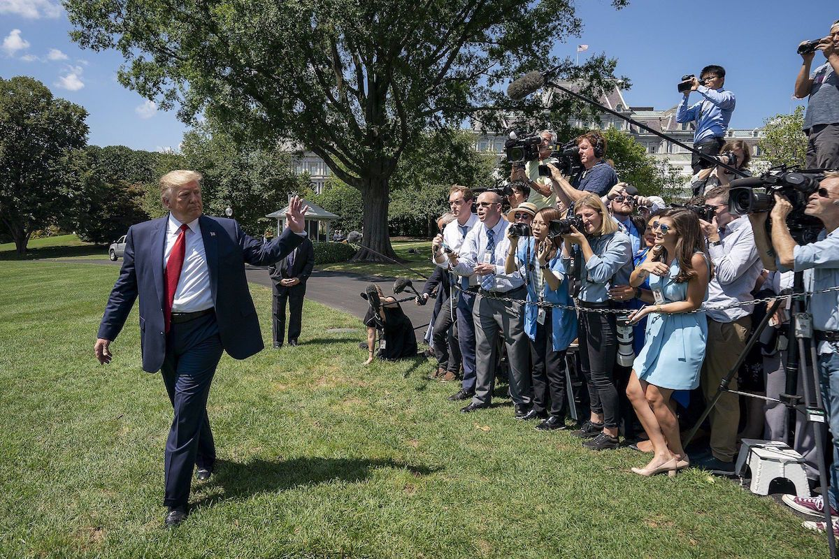 President Donald J. Trump waves as he walks to board Marine One on the South Lawn of the White House Wednesday, Aug. 21, 2019, to begin his trip to Louisville, KY. (Official White House Photo by Tia Dufour)