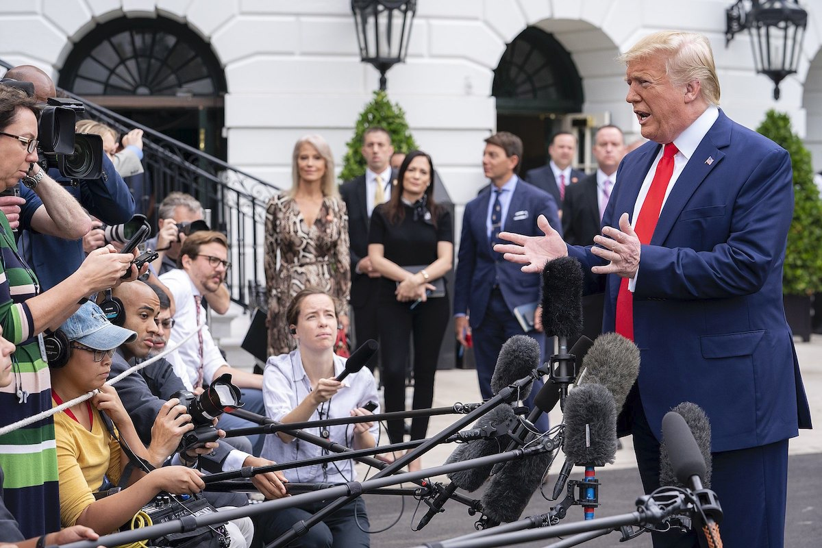 President Donald J. Trump speaks with reporters Thursday, Oct. 3, 2019, along the driveway outside the South Portico entrance of the White House, prior to boarding Marine One for his flight to Joint Base Andrews, Md., to begin his trip to The Villages, FL. (Official White House Photo by Tia Dufour)