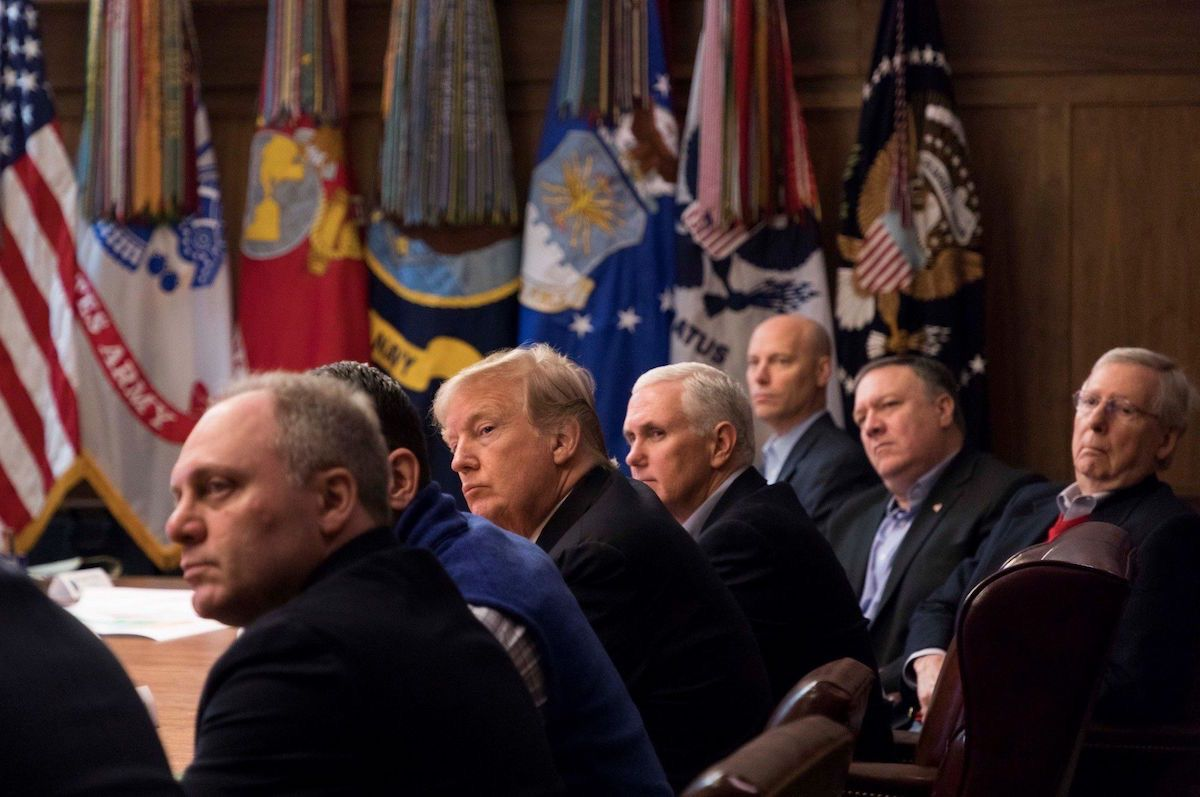 President Donald J. Trump, joined by Vice President Mike Pence and Republican legislative leaders, listen to a briefing in the Laurel conference room at Camp David, Saturday, January 6, 2018, near Thurmont, Maryland. (Official White House Photo by Joyce N. Boghosian)