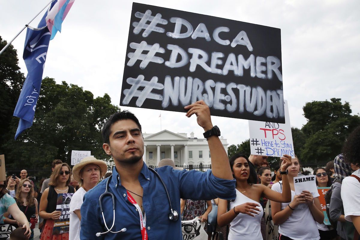 Carlos Esteban, 31, of Woodbridge, Va., a nursing student and recipient of Deferred Action for Childhood Arrivals, known as DACA, rallies with others in support of DACA outside of the White House, in Washington – Sept. 5, 2017 (AP Photo/Jacquelyn Martin)