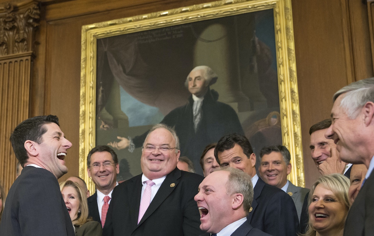 Then-Speaker of the House Paul Ryan, R-Wis., left, laughs with Majority Whip Steve Scalise, R-La., center right, just after Ryan signed an attempt to repeal Obamacare – Thursday, Jan. 7, 2016. (AP Photo/J. Scott Applewhite)