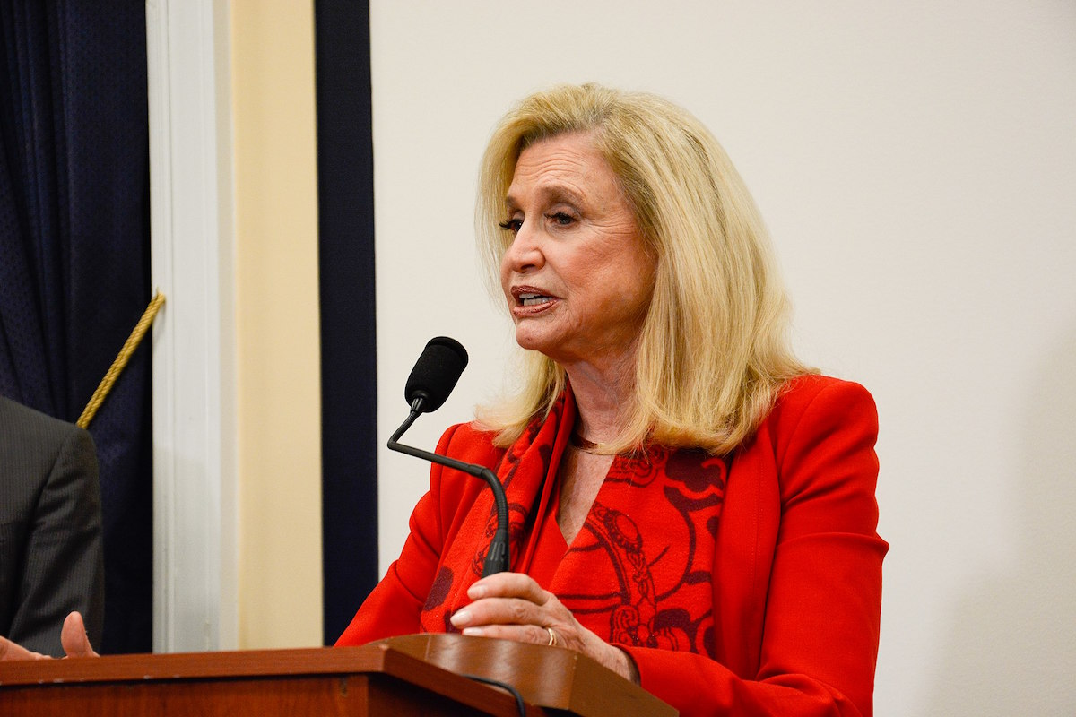 Chairwoman Carolyn Maloney and Representative Chrissy Houlahan and labor leaders discuss the paid parental leave provision in the final conference report for the National Defense Authorization Act for Fiscal Year 2020. (Source: AFGE/Creative Commons License)