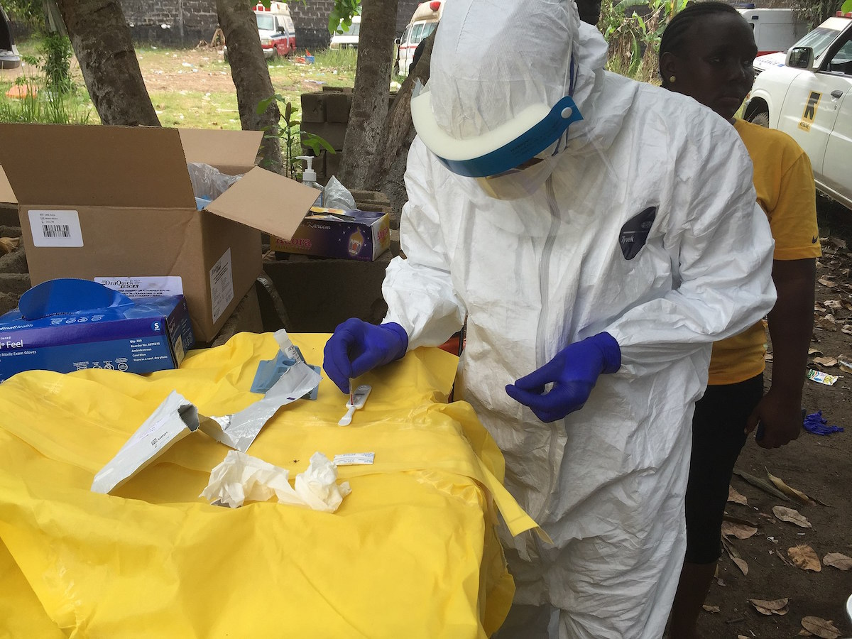 CDC disease detectives conducting testing out in the field during the 2014 Ebola outbreak in Liberia. (Photo credit: John Saindon/CDC)
