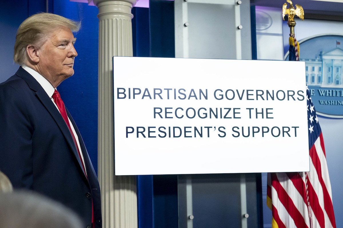 President Donald J. Trump listens as a White House video plays a campaign-style ad trying to defend their failed COVID-19 response- Monday, April 13, 2020, in the James S. Brady Press Briefing Room of the White House. (Official White House Photo by D. Myles Cullen)