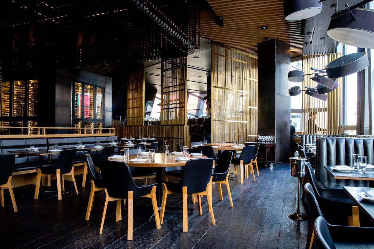 An empty restaurant. (Photo by Jason Leung on Unsplash)