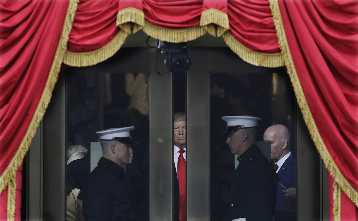 Donald Trump waits to step out onto the portico for his Presidential Inauguration at the U.S. Capitol in Washington, Friday, Jan. 20, 2017. (AP Photo/Patrick Semansky)