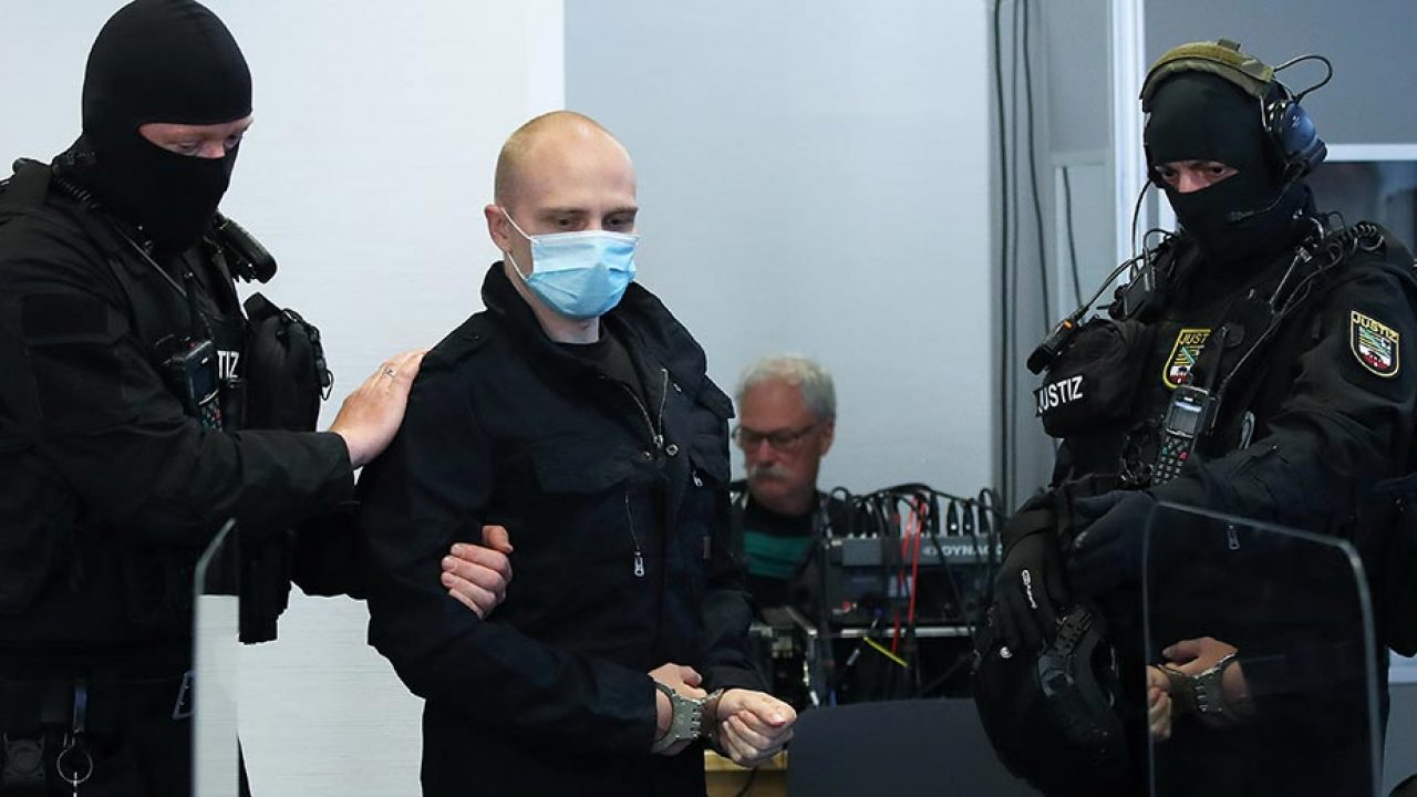 """Stephan Balliet, who is accused of shooting dead two people after an attempt to storm a synagogue in Halle, arrives at the district court in Magdeburg, eastern Germany on July 21, 2020. (Source: <a href=""""https://www.timesofisrael.com/austrian-rapper-arrested-for-neo-nazi-songs-tied-to-halle-synagogue-shooting/""""><em>The Times Of Israel</em> </a>– Ronny Hartmann/various sources/AFP)"""