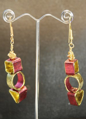 Friendly Plastic foiled and formed to make contemporary earrings. The shapes could be made larger to make Christmas Tree decorations