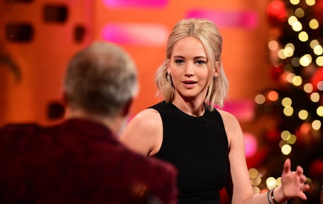 Host Graham Norton and Jennifer Lawrence during filming at the London Studios, London of The Graham Norton Show which is due to be transmitted on December 31 at 2245.
