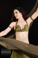 Oxford Bellydancer Rasha Nour dancing with a veil in an olive green costume