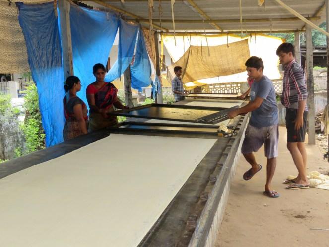 Workers manufacturing Kalamkari fabric using screen printing techniques