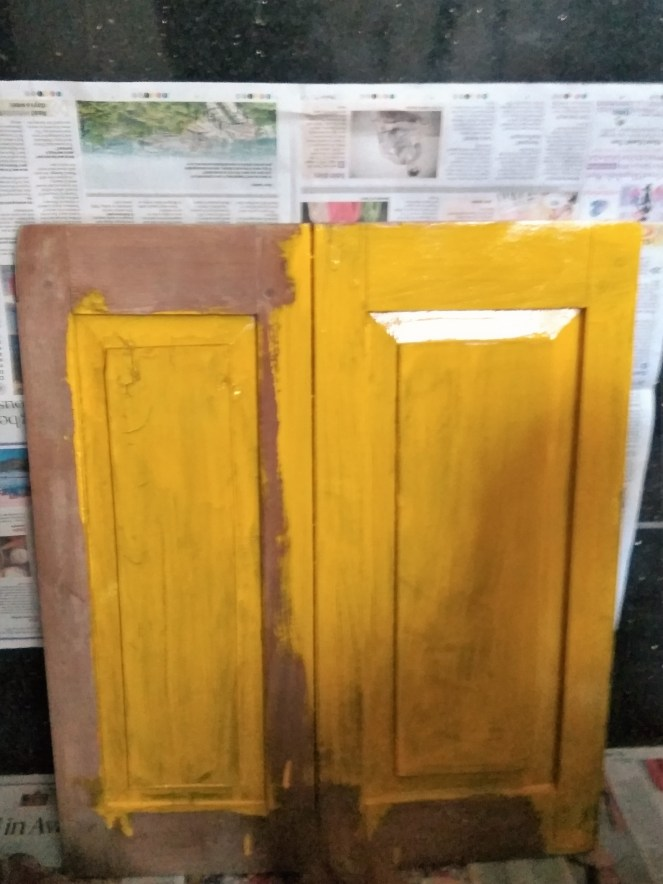 "Surface painted my favorite yellow. Given that the wood was really old, it looked naturally ""distressed""!"