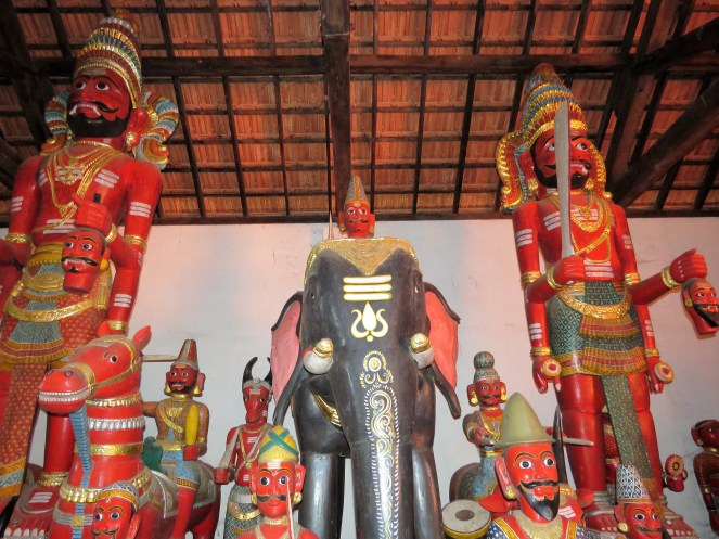 Wooden idols at the Nandikeshwara temple